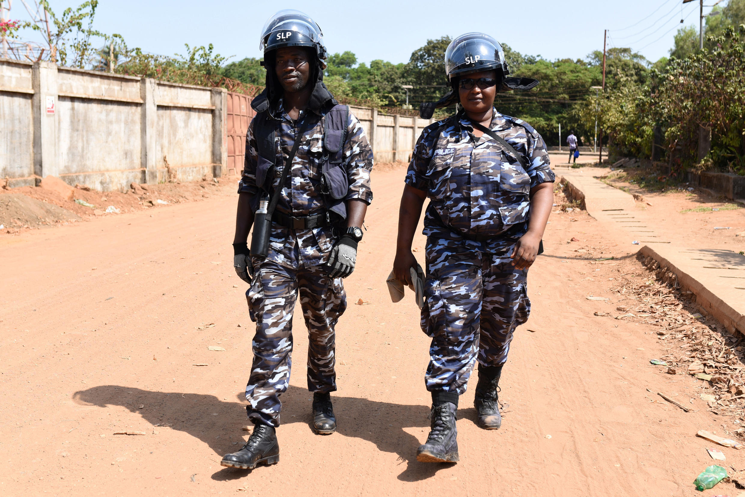 Police officers on patrol during elections on 7 March in Freetown.