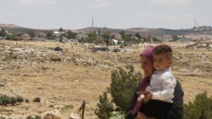 Palestinienne empêchée de gagner sa maison de la Zone C par les forces israéliennes, le 19 juin 2020 (Photo d'illustration).