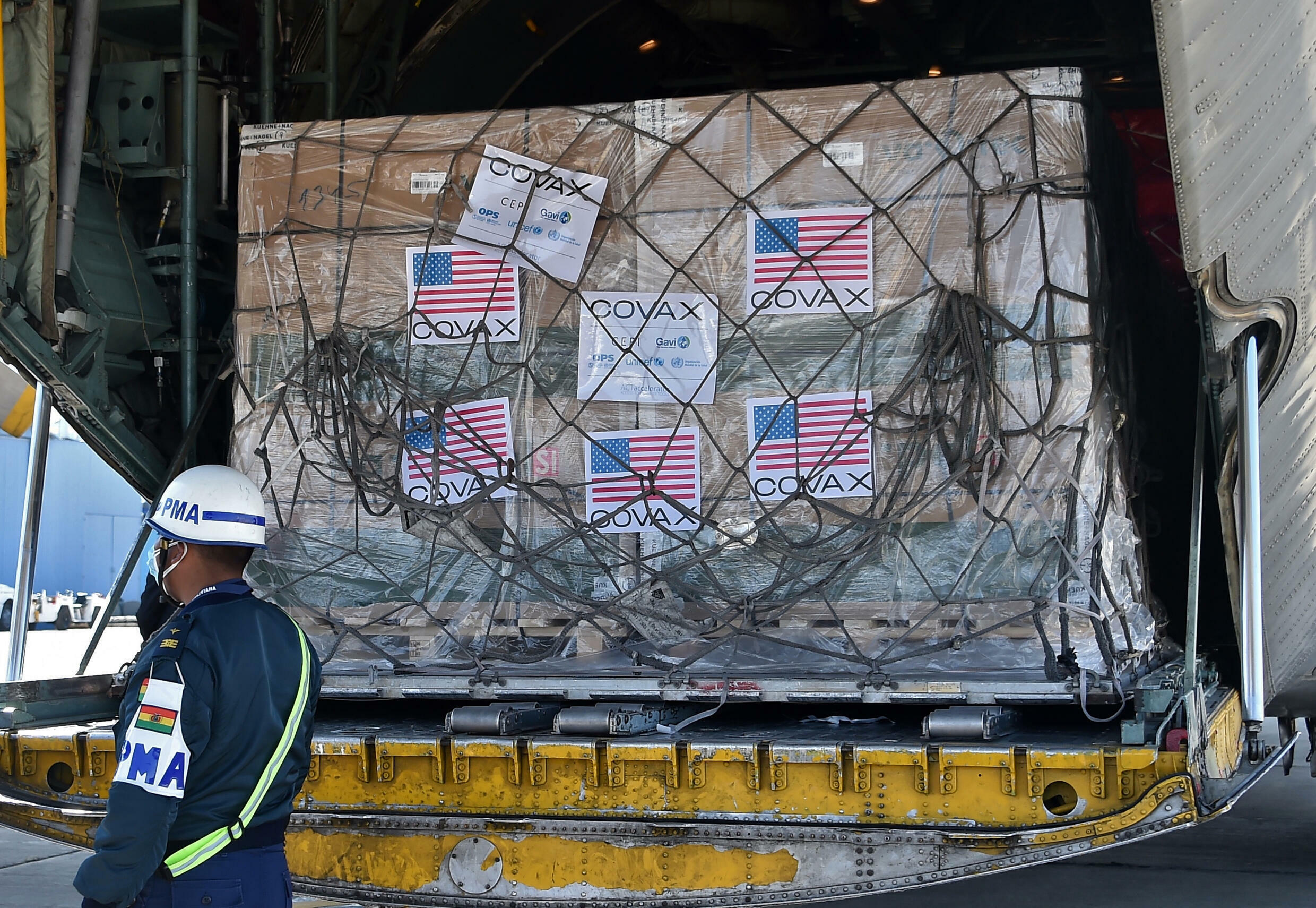 Boxes containing doses of US Johnson & Johnson Covid vaccines donated through the COVAX mechanism arrive in Bolivia