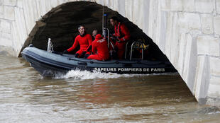 Fire brigade divers on the River Seine ain Paris