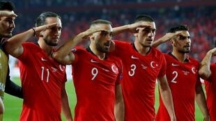 Turkish football players give a military salute after clinching the win in Friday's match against Albania, in a gesture many French observers perceive as a show of support for Ankara's military offensive against Kurdish fighters in north-eastern Syria.