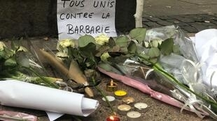 Flowers and messages commemorating victims of the Strasbourg attack in December 2018