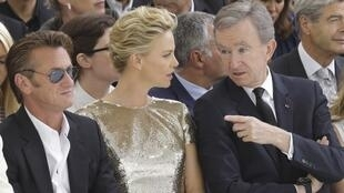 LVMH boss Bernard Arnault with actors Sean Penn and Charlize Theron at the Dior fashion show in Paris this week