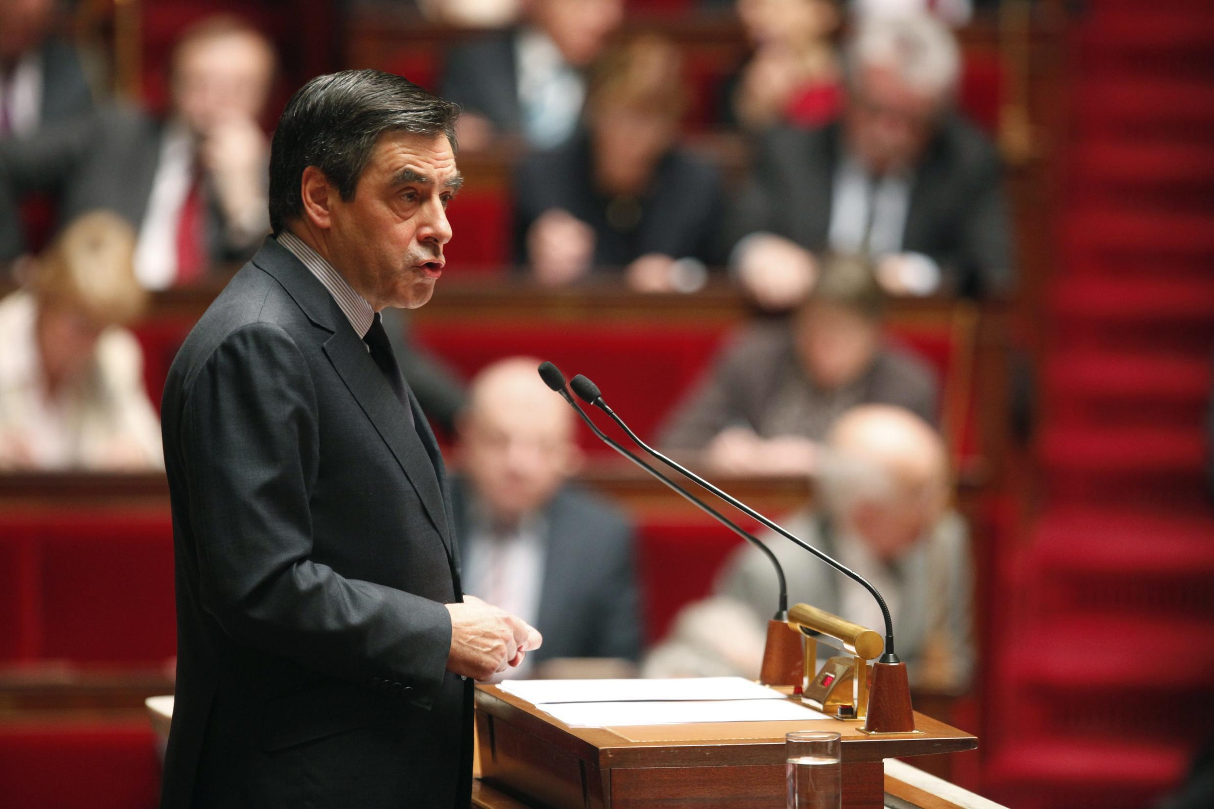 France's Prime Minister Francois Fillon delivers a speech during a debate on Libya at the National Assembly in Paris