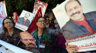 Lors de l'ouverture du procès des assassins présumés de Chokri Belaïd, devant le palais de justice de Tunis, le 30 juin 2015.
