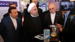 Picha iliyotolewa na Ofisi ya Hassan Rouhani Inaonyesha Rais wa Iran katika Sherehe huko Tehran ya Siku ya Kitaifa ya Teknolojia ya nyuklia, Aprili 9, 2018.