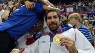 Nikola Karabatic shows off his Olympic gold, 2012