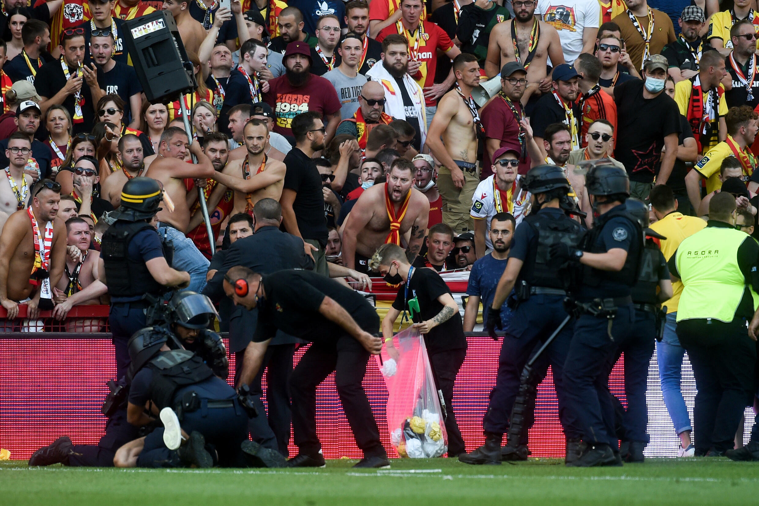 Riot police arrest a man during the trouble in the northern derby between Lens and Lille