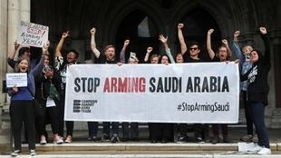 Demonstrators react after learning the British Court of Appeal ruled UK licences to export arms to Saudi Arabia is illegal, June 20, 2019