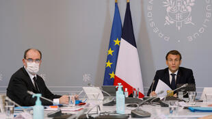 French President Emmanuel Macron, right, speaks next to French Prime Minister Jean Castex, left, during a videoconference 17 nov 2020