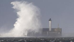 A lighthouse during a storm Christian at Boulogne sur Mer in northern France. 28 October 2013