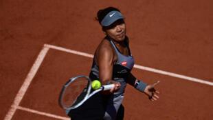 Into second round: Naomi Osaka returns the ball to Romania's Patricia Maria Tig