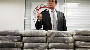 French Interior Minister Manuel Valls with some of the seized cocaine