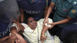 Police try to arrest a BNP activist in Dhaka on Sunday