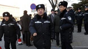 Les policiers chinois peuvent désormais être filmés lors d'une intervention. Photo illustration, le 26 novembre 2015 à Pékin.