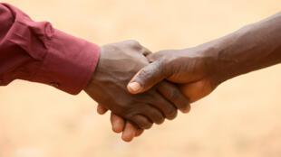 Afrique - Poignée de main - Aide - Salutation