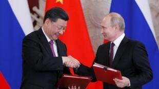 中国国家主席习近平与俄罗斯总统普京会晤。