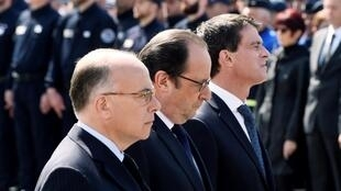 (From L) French Interior minister Bernard Cazeneuve, French President Francois Hollande and French Prime minister Manuel Valls attend a memorial ceremony honouring the police couple who were killed by an extremist pledging allegiance to the Islamic State.