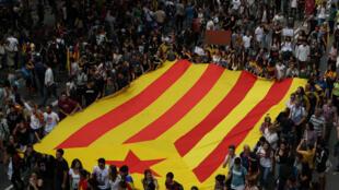 A ranar lahadi mutanen Catalonia suka kada kuri'ar ballewa daga Spain