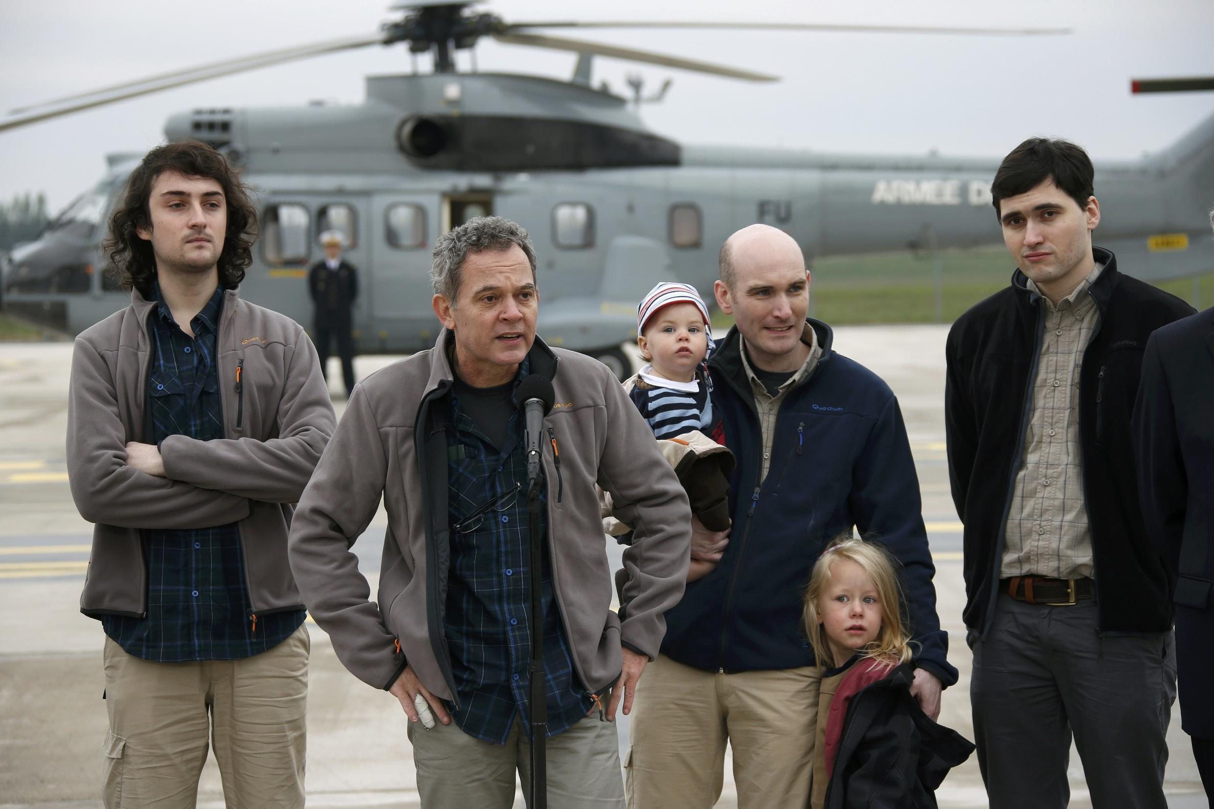 The four French journalists released from captivity arrive back in France (l-r) Edouard Elias, Didier François, Nicolas Hénin and Pierre Torres