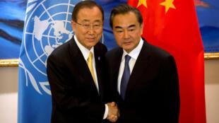 圖為聯合國秘書長潘基文會見中國外長王毅