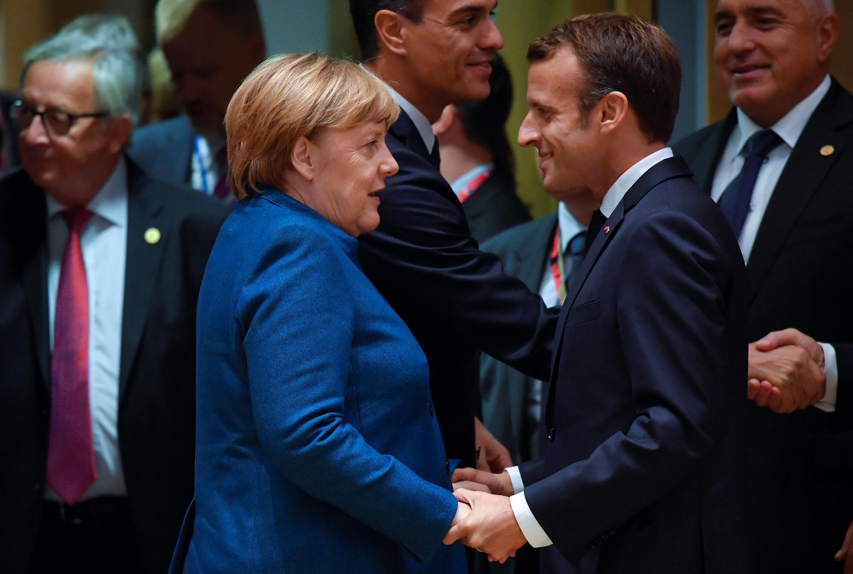 Ангела Меркель и Эмманюэль Макрон в Брюсселе 17 октября 2018 года