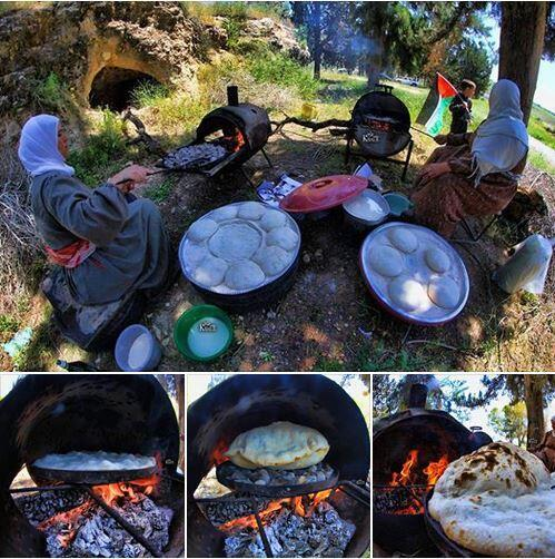 Palestinian women using a traditional clay oven