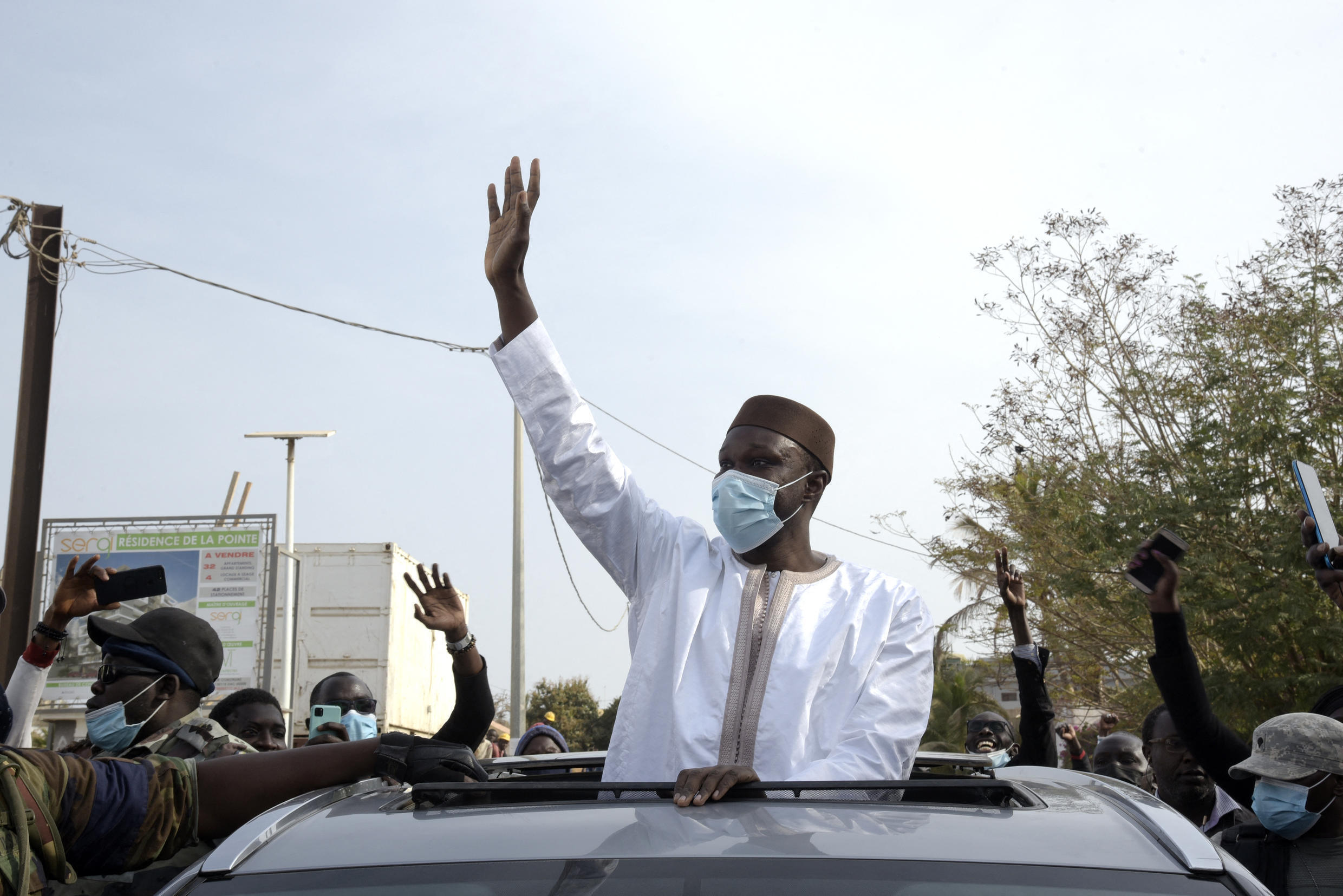 Senegalese opposition leader Ousmane Sonko waves to supporters in Dakar, prior to his arrest. 3 March 2021.