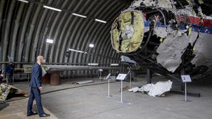 Presiding judge Hendrik Steenhuis surveys the reconstructed wreckage of Malaysia Airlines Flight MH17