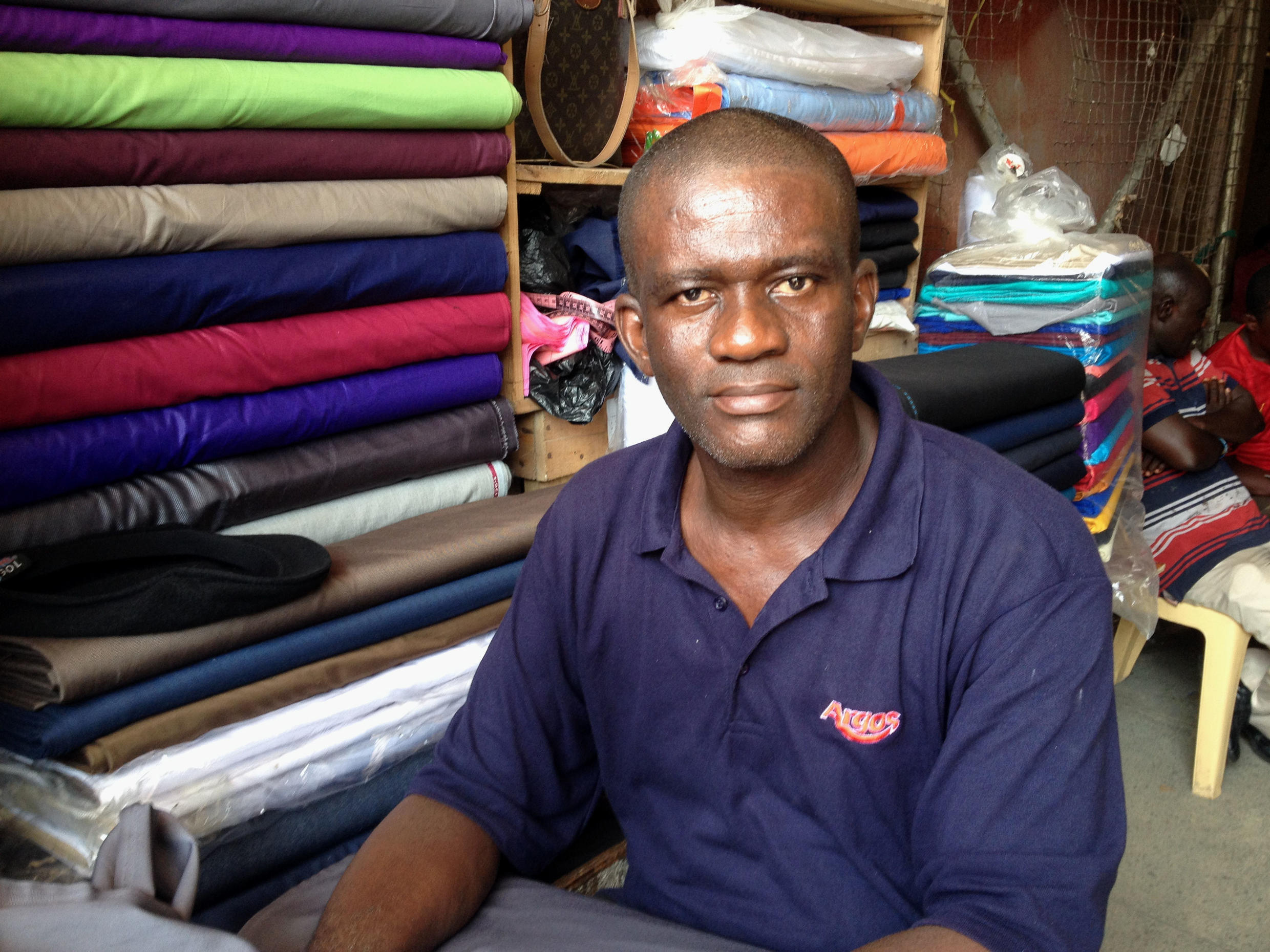Trader Christian Ezeji sells fabric for school uniforms and suits.