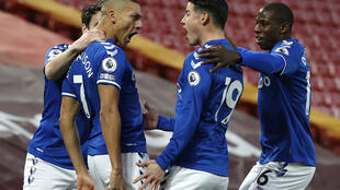 What a start: Everton's Brazilian striker Richarlison celebrates scoring his team's first goal