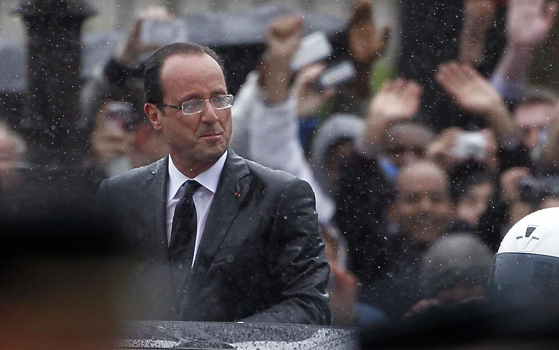 François Hollande has earned the nickname Rainman after the weather put a damper on his investiture