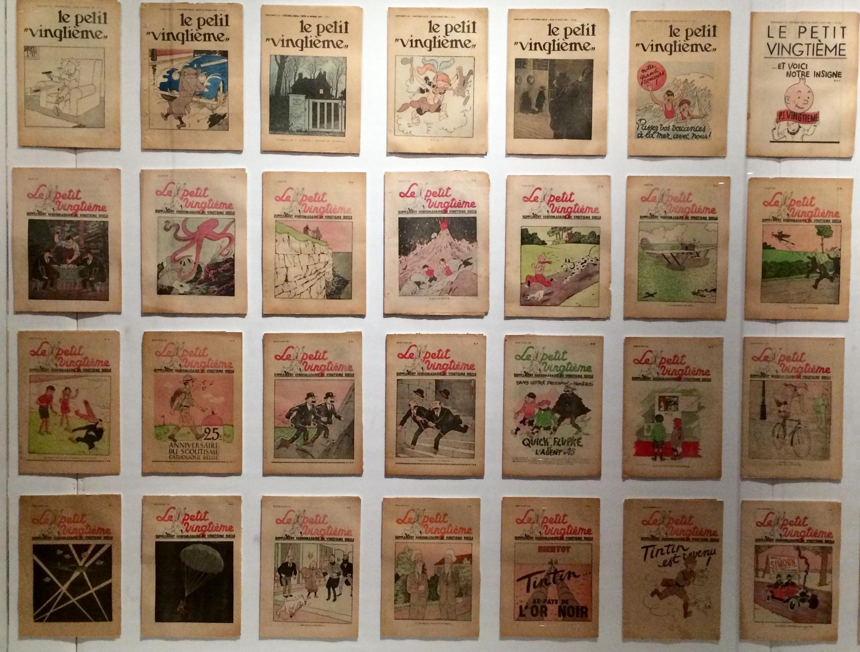 Bìa tạp chí Le Petit Vingtième (1929-1940) đăng loạt phiêu lưu của Tintin. Triển lãm Hergé, Grand Palais, Paris.