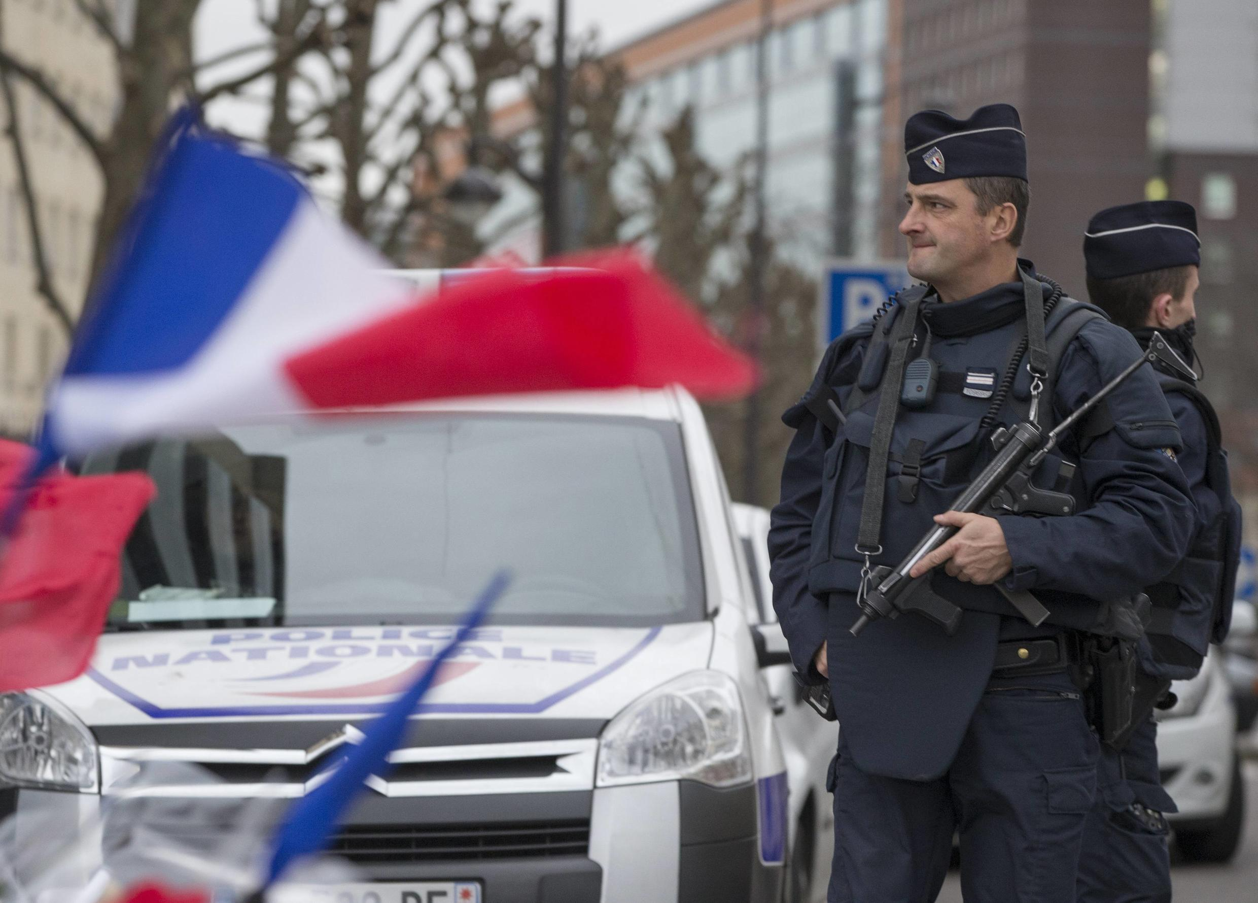 Police in front of the Hyper Cacher supermarket in Paris, where Amedy Coulibaly killed four people