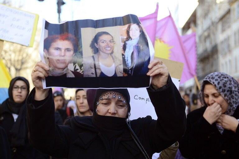 A protester holding photos of the three Kurdish activists, during a demonstration on 10 January 2013, in Marseille, right after their murders