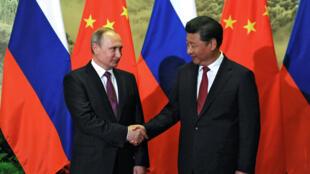 Tổng thống Nga Vladimir Putin và chủ tịch Trung Quốc Tập Cận Bình tại Bắc Kinh ngày 25/06/2016.
