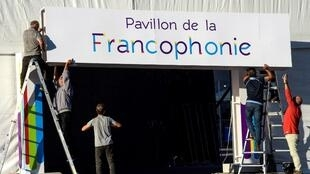 Workers hang a sign for the forthcoming XVII Francophone countries summit to be held in Yerevan.
