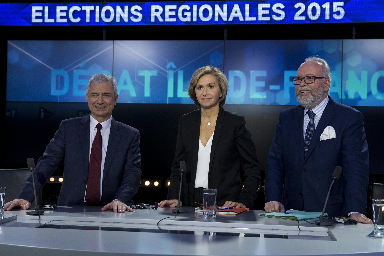 Los candidatos Claude Bartolone (Partido Socialista),  Valérie Pécresse (Los Republicanos) y Wallerand de Saint Just (Frente Nacional) durante un debate el 9 de diciembre de 2015.