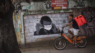 Brazilian President Jair Bolsonaro wears a face mask in this informal mural, even though he has downplayed the severity of the COVID-19 pandemic