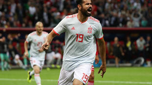 Spain's Diego Costa celebrates after scoring the winning goal against Iran.