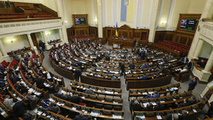 Ukrainian deputies attend a session of parliament in Kiev, Ukraine.
