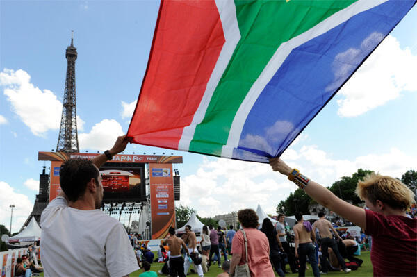 Fans gather near a giant screen by the Eiffel Tower in Paris to watch a 2010 World Cup match