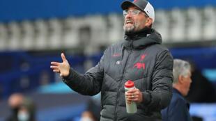 Jurgen Klopp gestures on the touchline during Liverpool's match against Everton