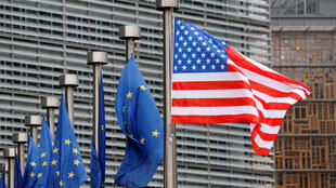 US and European Union flags outside the European Commission headquarters in Brussels.