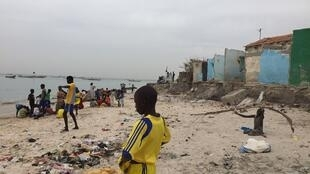 Dozens of homes on the shoreline have been swallowed up by rising sea levels, Bargny, Senegal in December 2015.