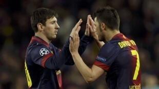 Lionel Messi et David Villa (FC Barcelone), pendant le match contre le PSG, à Camp Nou, le 10 avril 2013.