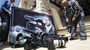 Poster of Lebanon's Al-Jadeed television cameraman Ali Shaaban during his funeral, in southern Lebanon, 10 April 2012