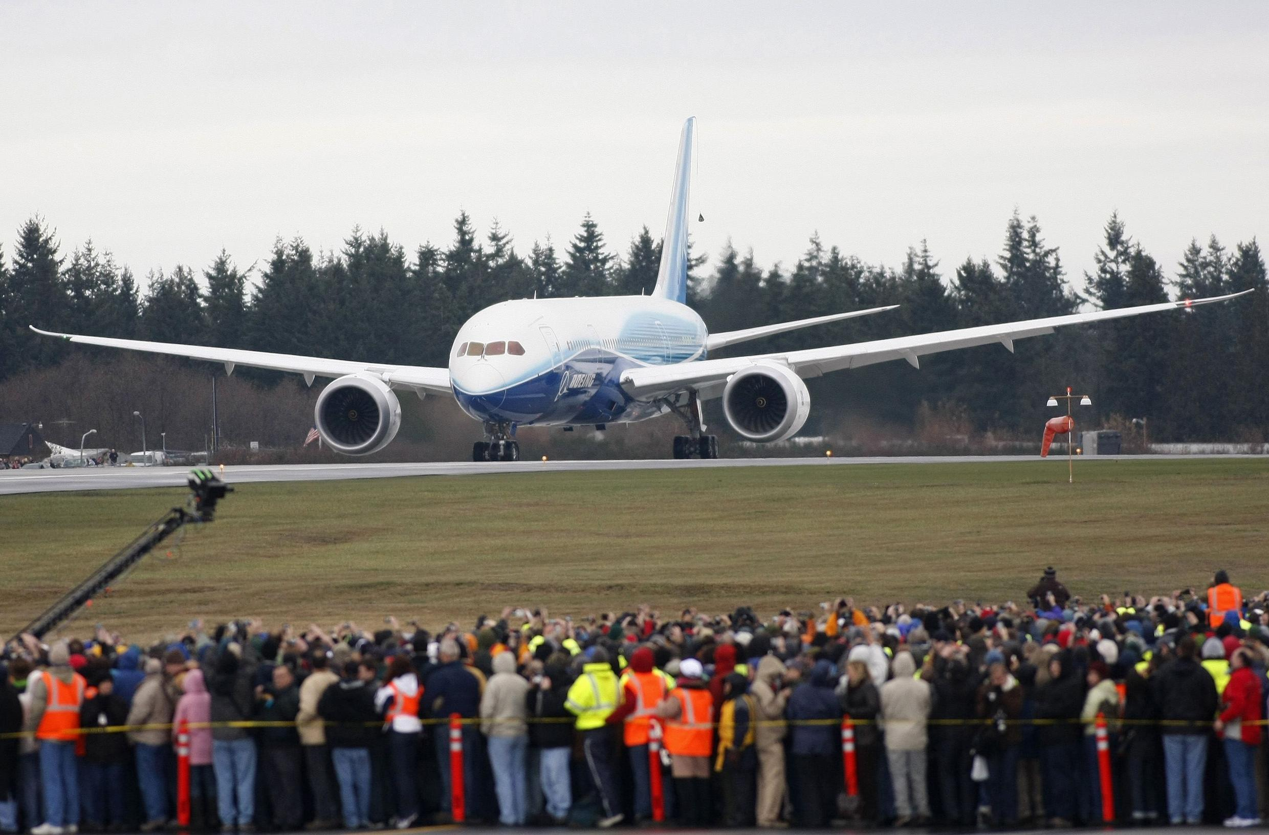 File photo of Boeing employees crowding the tarmac as the company's 787 Dreamliner taxies down the runway