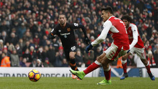 Arsenal's Alexis Sanchez scores his team's second goal from the penalty spot against Hull City on Saturday.