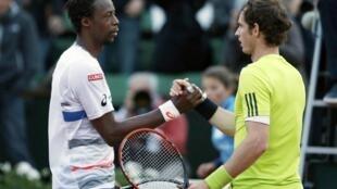 Andy Murray shakes hands with Gael Monfils after winning their men's quarter-final match
